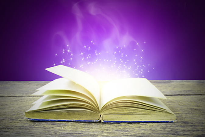 Open magic book with purple background